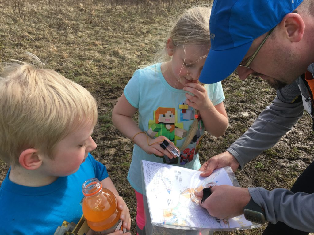 The author, Andreas Johansson, teaching his kids about orienteering.